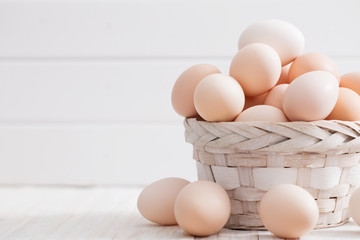 eggs on white wooden background