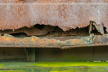 Part of an old railway freight wagon with a rusty side