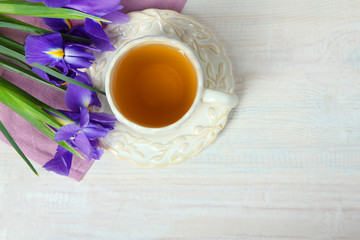narcissus and a cup with tea