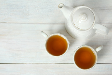 A cup with tea and teapot