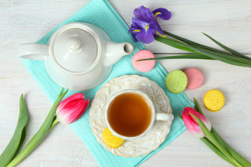 Table setting with spring flowers and sweets.
