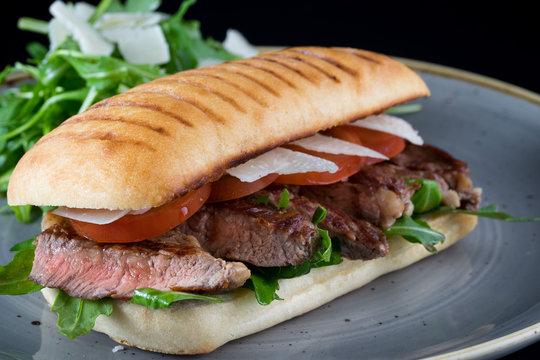 grilled steak medium fresh baked ciabatta sandwich beer