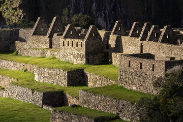 Atmospheric view of typical buildings and terraces in sunlight, Machu Picchu, Unesco World Heritage site, Sacred Valley, Peru