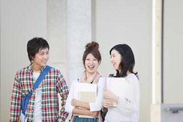 Three university students talking