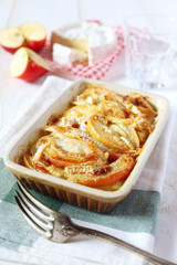 Gratin of potatoes, apples and  Camembert cheese
