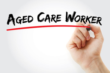 Hand writing aged care worker with marker, concept background