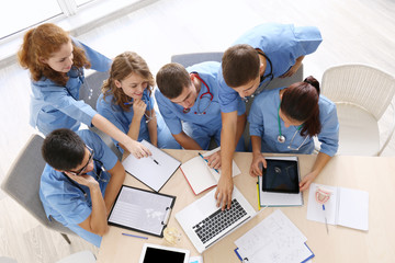 Medical students studying at university indoors