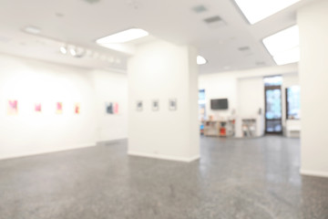 Blurred view of empty art gallery with pictures