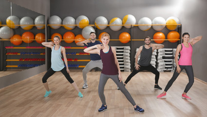 Young sporty people training in gym