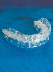 Invisible dental aligners modern tooth brackets transparent braces to straighten teeth in cosmetic dentistry and orthodontics. Individual tooth tray for whitening also.