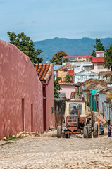 Trinidad, Cuba -March 8, 2016: A vintage car in front of colorful houses on a cobblestone street in Trinidad, Cuba.