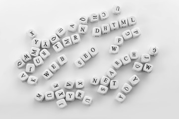 Few Internet science words as SEO, DHTML, WEB, SEARCH, NET spelled by dice with english letters