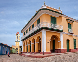Trinidad, Cuba -March 8, 2016:  Beautiful architecture of Palacio Brunet in Trinidad and the bell tower in the background.