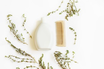 Flat lay bath products/ Natural bath products. Shampoo and wooden comb. Top view photography