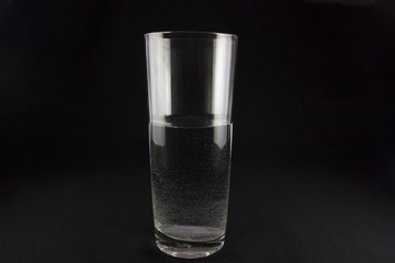 glass of water with bubbles on dark background