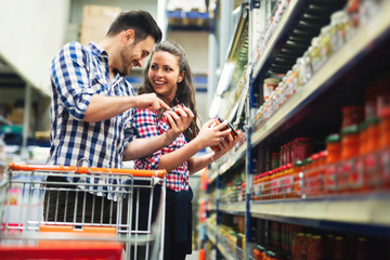 Couple shopping in store for food