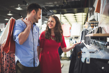 Couple in love shopping in store for clothes