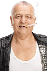 Portrait of an elderly punker with a cigarette