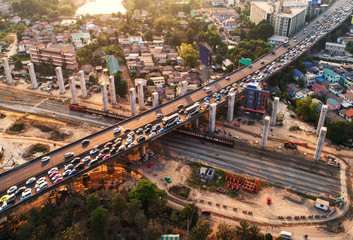 Traffic jam in rush hour,expressway. Freight and passenger train waiting at the train station parking lot.Cargo transit.import export and business logistic.Aerial view.Top view. Railway construction