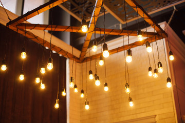 composition of lamps hanging in wedding ceremony area