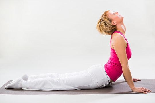 Woman exercising yoga indoor,Cobra Pose/Bhujangasana