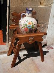 Ceramic vase on wooden stand