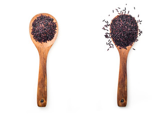 Raw black rice in wooden spoon