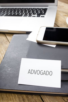 Advogado, Portuguese text for Attorney business card on office desktop with electronic devices