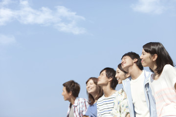 Six young people looking at the sky