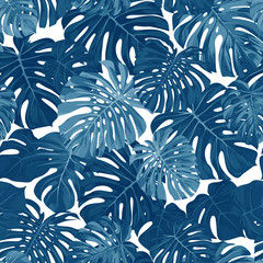 Indigo vector pattern with monstera palm leaves on dark background. Seamless summer tropical fabric design.