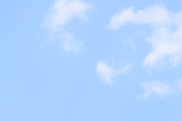 White fluffy clouds in  blue sky and space