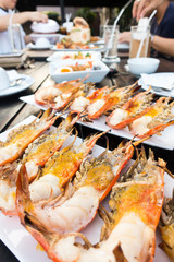 Grilled river prawns or shrimp on white dish in restaurant.selective focus