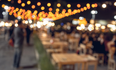 blurred bokeh cafe and restaurant background with vintage filter -