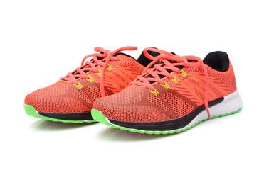 Pair of new bright orange modern sneakers