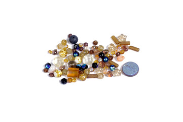 Pressed multicolored glass beads on white background - isolated