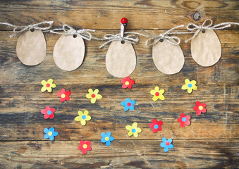 Easter paper tag shape of an egg hanging on rope, applique flowers