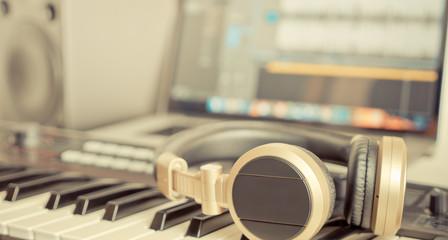 Golden Music Studio headphone lying on working desktop