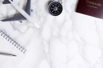 Travel blogger acessories on luxury marble surface with copy space.