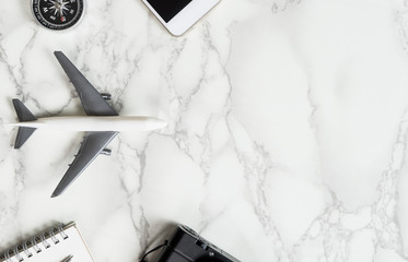Travel acessories on luxury marble surface with copy space.