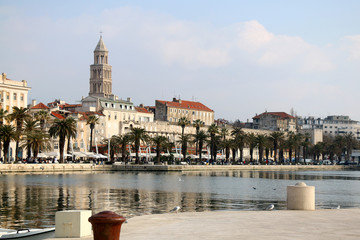 Waterfront in Split, Croatia. Seagulls on Matejuska cove with The Riva promenade and Saint Domnius bell tower in the background. Landmarks in Split.