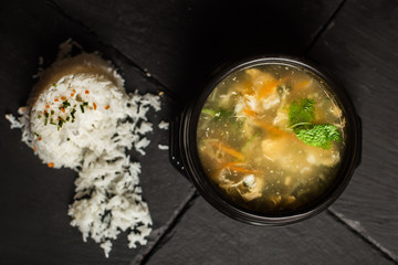 Chinese chicken soup with rice. Traditional food. Restaurant