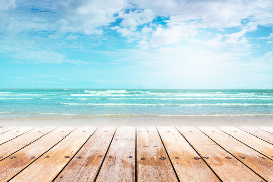 old wood table top on blurred beach background. Concept Summer, Beach, Sea, Relax.