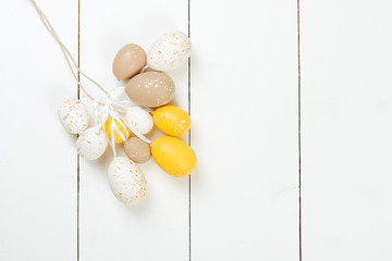Easter card. Easter eggs on white wooden background.
