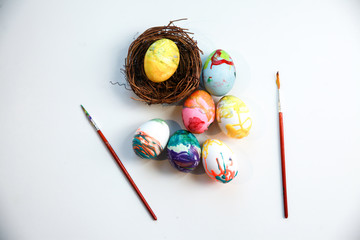 Colorful eggs and brushes