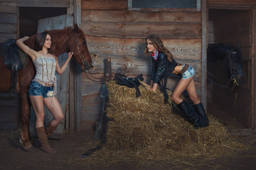 Two women are on the ranch near the stables, they talk to each other.