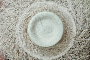 Close up view from above of an unfinished authentic Panama hat, Cuenca, Ecuador