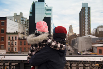 Father and Daughter standing on High Line look at New York City Cityscape