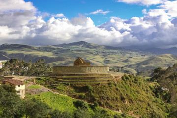 Panorama Inca ruins of Ingapirca and surrounding green andean landscape with dramatic sky, Ecuador