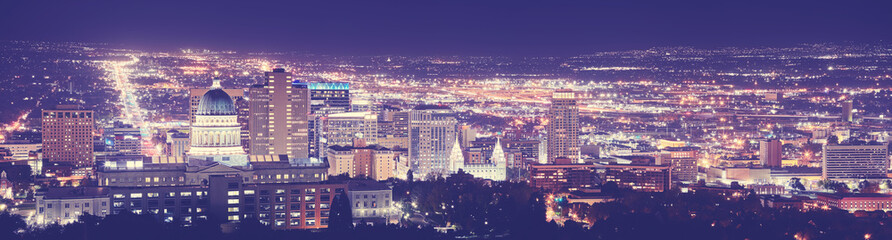 Vintage toned Salt Lake City downtown night panorama, Utah, USA.