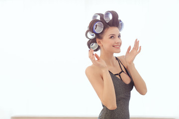 Woman in hair curlers indoors